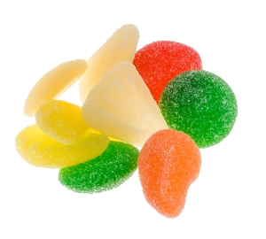 Haribo Gummi Fruit Salad is fruit flavored gummy candy in green orange white and red