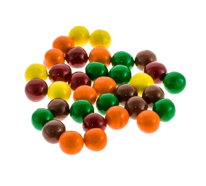 Sixlets are hard chocolate candy in yellow green purple and orange