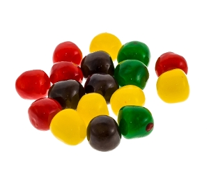 Assorted Fruit Sours candy in red purple yellow and green