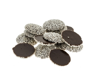 Dark Chocolate Nonpareils are dark chocolate candy with white nonpareils