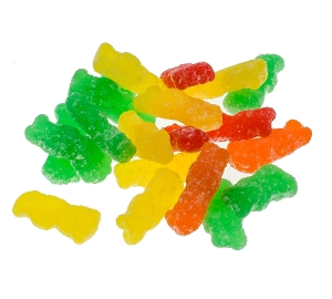 Sour Patch Kids are gummy candy coated in sugar in green yellow red and orange